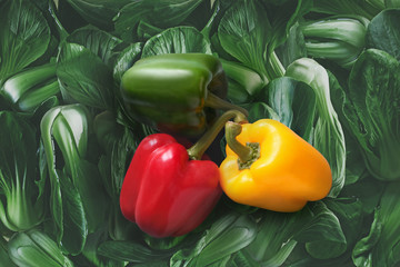 bell peppers on Green leafy vegetables, China. Top view