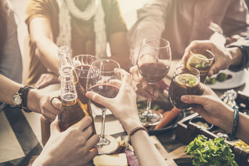 Group of people having meal togetherness dining toasting glasses
