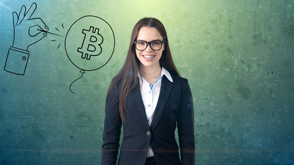 Successful business woman standing near btc logo. She needs to buy or sell Bitcoin. Concept of virtual criptocurrency.