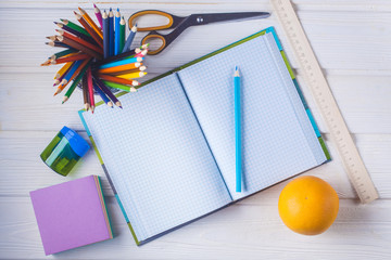 stationery on a white wooden background