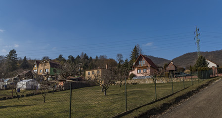 Path near Lovos hill in north Bohemia with houses