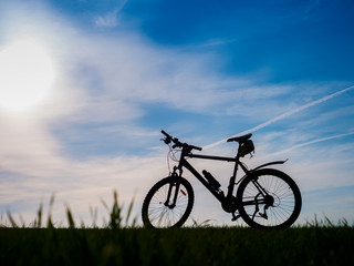 Bicycle silhouettes on the dark background of sunsets