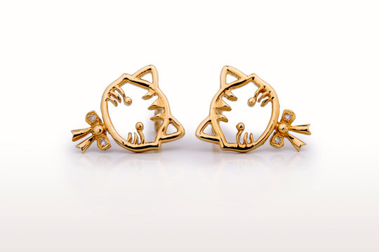 Beautiful Cute Baby & Kids earrings Jewelry with the cat design and a bow tie in yellow gold and diamond, ideal birthday baby gift isolated on white background