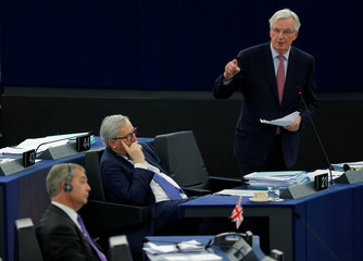 European Commission President Juncker and Brexit campaigner and Member of the European Parliament Farage listen to European Union's Chief Brexit negotiator Barnier, in Strasbourg