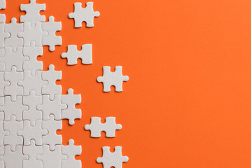 Wall Mural - White details of puzzle on orange background