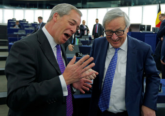 Brexit campaigner and MEP Farage talks to European Commission President Jean-Claude Juncker ahead of a debate on the guidelines on the framework of future EU-UK relations in Strasbourg