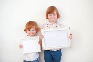Children with frames in their hands on the white background