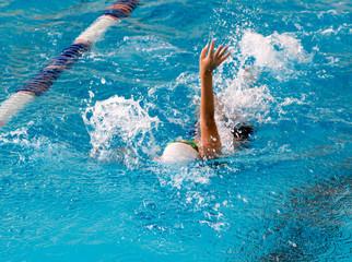 boy on a swim in a sports pool