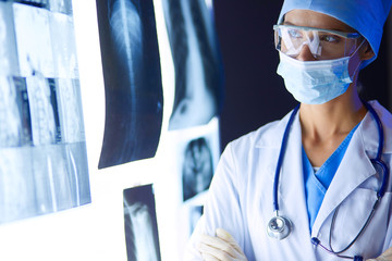 Image of attractive woman doctor looking at x-ray results.