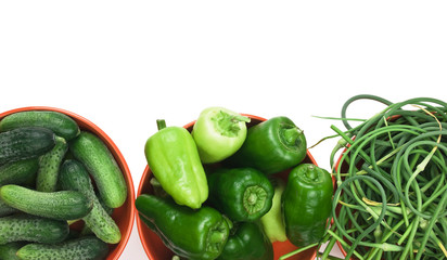 green peppers, cucumbers and garlic in a bowl