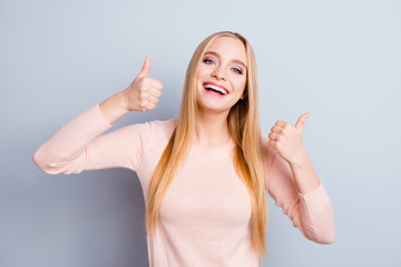 Casual beauty emotion expressing long hairstyle success people concept. Portrait of cheerful laughing delightful rejoicing cute sweet teenager making double thumbs-up isolated on gray background