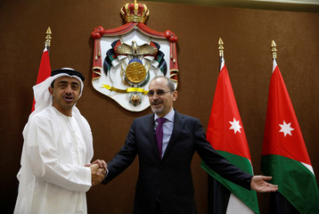 Jordanian Foreign Minister Ayman Safadi shakes hands with his UAE's counterpart Sheikh Abdullah bin Zayed Al Nahyan before their meeting in Amman