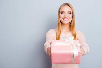 Style stylish trendy people person sale discount concept. Portrait of cute sweet lovely adorable excited cheerful toothy beaming smile girl giving you a present isolated on gray background copy-space
