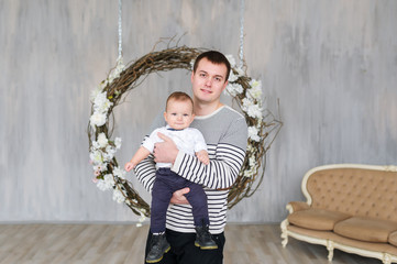 Lifestyle portrait of dad and one years old child son.
