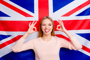 International background success tell talk chat teen age symbol union jack people person happiness concept. Portrait of excited cheerful delightful rejoicing linguist polyglot making ok with fingers