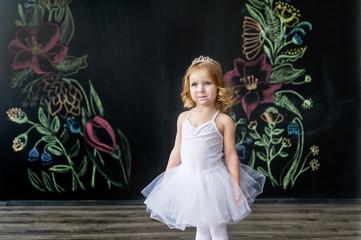 Little ballerina in white dress
