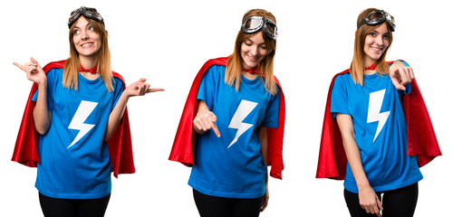 Pretty superhero girl pointing down, front and laterals