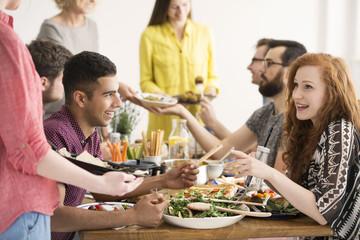 Vegan friends eating healthy salad