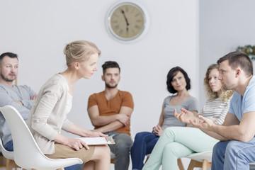 Therapist talking to man