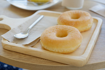 Close up Delicious donuts on wooden plate