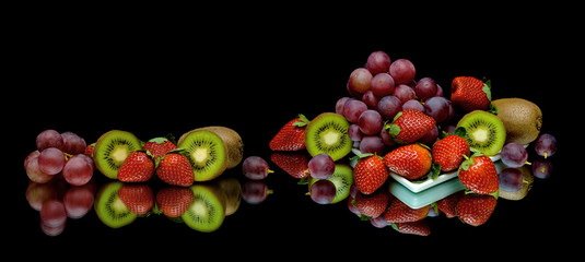 berries and fruits on a black background