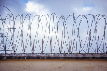 Prison wall with barbed wire in Poland