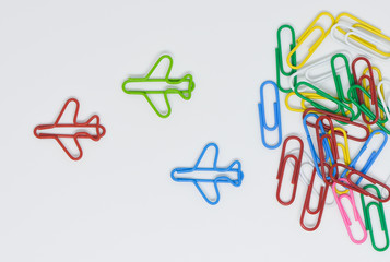 Business concept for group of stacked paperclip with group of red plane paperclip is point to another direction as a team leadership and difference thinking