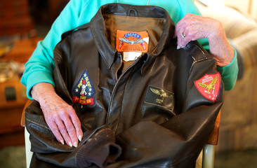 """Shirley Hollenback, wife of Gerald""""'Cactus"""" Hollenback, whose husband's ashes were lost by Sunset Mesa Funeral Directors poses with his Marine Corps bomber jacket in her home in Montrose"""