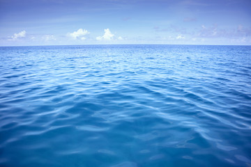 deep blue sea water with white cloud over sky