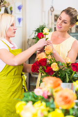 Women in the flower store buying beautiful roses