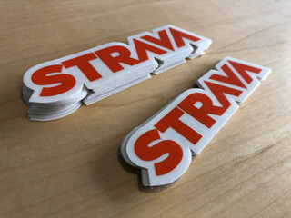 Stickers with the Strava Inc logo greet visitors at the fitness app company's headquarters in San Francisco