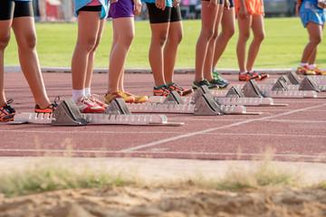 Athletics people running on red running track