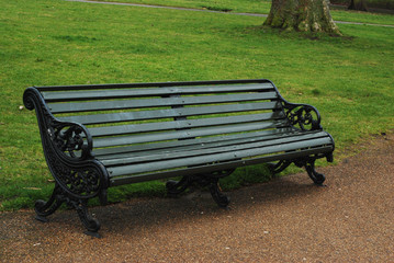 Empty Bench in a Rainy day in the Park. Resti Time.