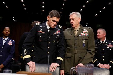 U.S. Army General Joseph Votel, commander of the U.S. Central Command, speaks with U.S. Marine Corps General Thomas Waldhauser, the commander of U.S. Africa Command, at right, as they arrive to testify before the Senate Armed Services Committee on Capitol
