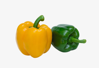 Green and yellow sweet bell pepper isolated on white background, close up.