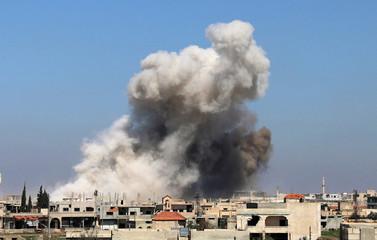 Smoke rises in Busra al-Harir town, near Deraa