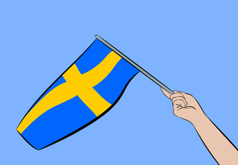 Female hand with flag of Sweden on a blue sky