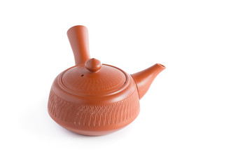 Japanese tea set. Ceramic teapot and a steaming cup Isolated on white background