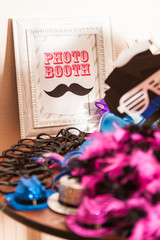Table of Photobooth Props with Sign