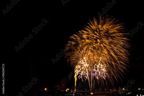 beautiful golden firework display for celebration happy new year and merry christmas in the night sky