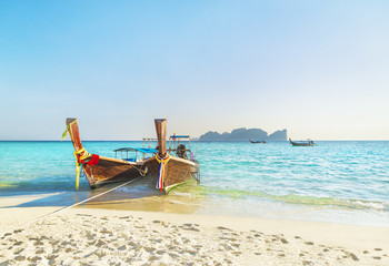 Two traditional thai longtail boats at famous sunset Long Beach, Thailand, Koh Phi Phi Don island, Krabi province, Andaman sea