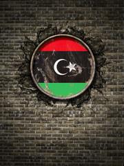 Old Libya flag in brick wall