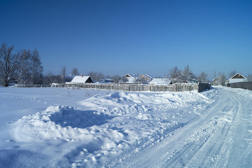 Winter landscape with expensive in village