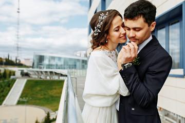 wedding photoshoot beautiful couple bride and groom long veil and white dress on mountains background lake Como Italy ceremony luxury beautiful sunny day