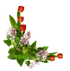 Red tulip and lilac flowers in corner arrangement