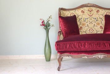 Red classical style sofa in the room.