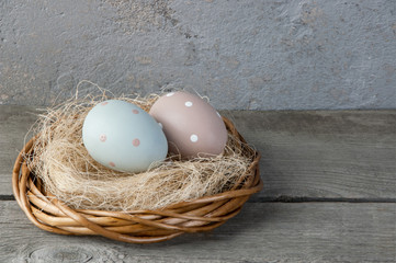 Eggs in the nest on old wooden background