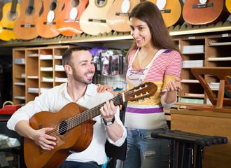 couple choosing acoustic guitar