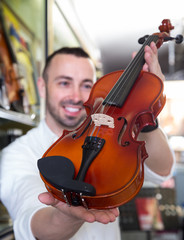 Male selecting classical violin