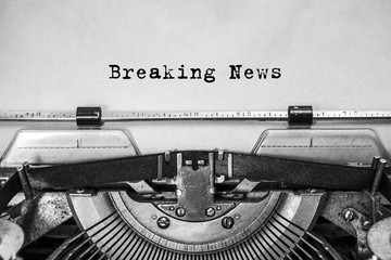 Breaking News text typed on an old typewriter. news time